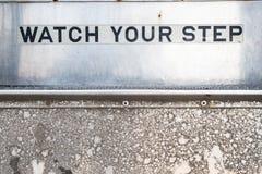 Olhe seu sinal da etapa em escadas imagens de stock royalty free