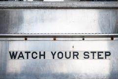 Olhe seu sinal da etapa em escadas foto de stock
