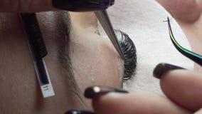 Olho da mulher com pestanas longas Extensão da pestana Chicotes, fim acima filme