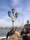 Olho de Londres da ponte de Westminster Foto de Stock Royalty Free