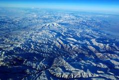 Olho do pássaro as montanhas da neve Imagens de Stock