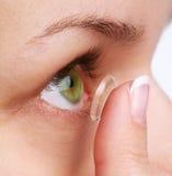 Olho humano com lente corretiva fotografia de stock royalty free