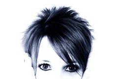 Olhos bonitos no azul Imagens de Stock Royalty Free