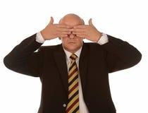 Olhos da coberta do homem de negócios Imagem de Stock Royalty Free