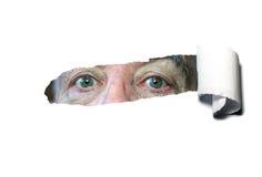 Olhos de revelação rasgados do papel. Fotografia de Stock