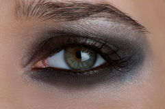 Olhos do fumo Imagens de Stock Royalty Free