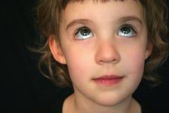 Olhos do rolamento da menina imagem de stock