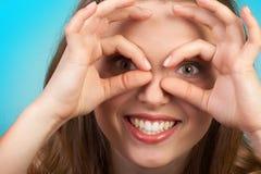 Olhos engraçados da mulher fotografia de stock royalty free