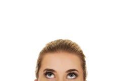 Olhos fêmeas bonitos que olham acima Fotos de Stock Royalty Free