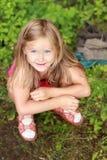 Olhos grandes de uma menina de sorriso Fotografia de Stock Royalty Free