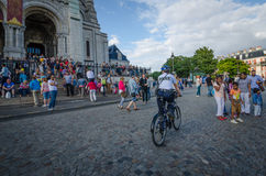 Oliceman on bicycle patrols area around Sacre-Coeur Basilica Stock Images