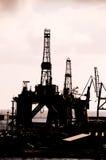Olie die Rig Silhouette boren Stock Afbeeldingen