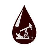 Oliepomp in een daling van olie. Stock Afbeeldingen