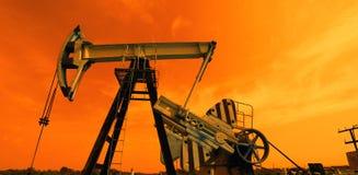 Oliepomp in rode tonen stock afbeelding