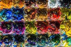 Olieverven van verschillende kleuren op het palet Stock Foto