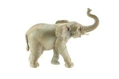 Olifantsstuk speelgoed op witte achtergrond wordt geïsoleerd die Royalty-vrije Stock Afbeeldingen