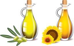 Olijf en zonnebloemoliën op wit worden geïsoleerd dat Royalty-vrije Stock Foto