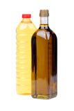 Olijfolie en de olieflessen van de Zonnebloem Stock Foto's