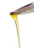 Olijfolie en lepel Stock Afbeelding