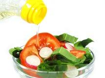 Olijfolie en salade Royalty-vrije Stock Afbeelding