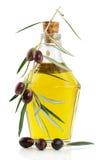 Olijfolie en tak van een olijfboom Stock Foto