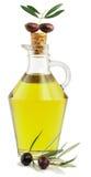Olijfolie en tak van een olijfboom Stock Afbeeldingen