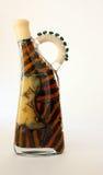Olijfolie in kleurrijke fles Stock Afbeelding