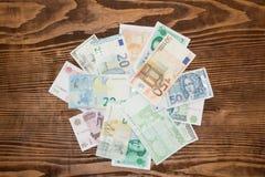 Olik bakgrund för pappers- pengar för värld Royaltyfri Bild
