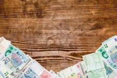 Olik bakgrund för pappers- pengar för värld Arkivfoto
