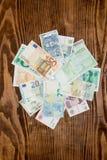 Olik bakgrund för pappers- pengar för värld Arkivbilder
