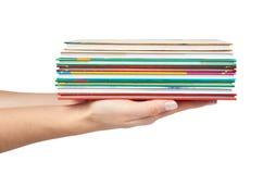 Olik colorfull bokar i bunt med handen som isoleras på vit bakgrund Royaltyfria Bilder