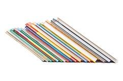 Olik colorfull bokar i bunten som isoleras på vit bakgrund Royaltyfria Foton