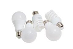 Olik energi - sparande elektriska lampor av olika typer Fotografering för Bildbyråer