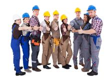 Olik grupp av arbetare upp ge tummar Arkivbild
