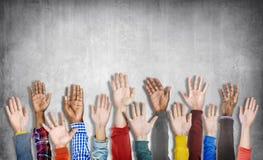 Olik grupp av lyftta händer Arkivbild