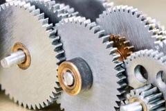 Olik metall skrapade kugghjulkugghjul för maskinmakro Royaltyfri Foto
