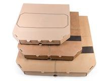 Olik pizza tre i de stängda kartongerna arkivfoton