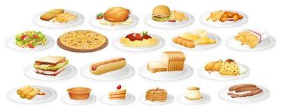 Olik sort av mat på plattor Fotografering för Bildbyråer