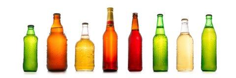 Olika ölflaskor med vatten tappar samlingen Royaltyfri Fotografi