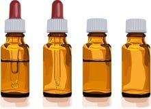 Olika bruna glasflaskor för medicin Arkivbild