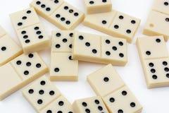 Olika diagram för dominobricka på vit bakgrund royaltyfri fotografi
