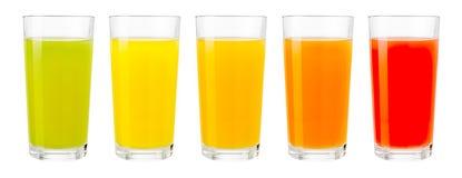 Olika färgfruktfruktsafter i isolerade exponeringsglas royaltyfria bilder