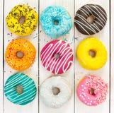 Olika färgrika donuts Fotografering för Bildbyråer