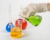olika färgrika flaskor Arkivfoto