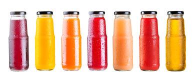 Olika flaskor av fruktsaft som isoleras på vit bakgrund Fotografering för Bildbyråer