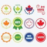 Olika färger röstar Kanada emblem och planlägger beståndsdeluppsättningen Fotografering för Bildbyråer