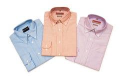 olika isolerade skjortor Arkivbild