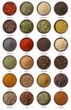 Olika kryddor som isoleras på vit bakgrund. Arkivfoton