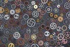 Olika kugghjul som lägger på grå bakgrund Arkivbilder