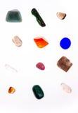 Olika mineraler på vit bakgrund Royaltyfri Bild